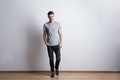 Full length portrait of a young man in a studio. Copy space. - PhotoDune Item for Sale