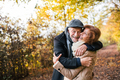 Senior couple standing in an autumn nature, hugging. - PhotoDune Item for Sale