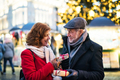 Senior couple on an outdoor Christmas market. - PhotoDune Item for Sale