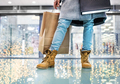 Legs of senior woman with bag doing Christmas shopping. - PhotoDune Item for Sale