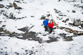 A senior couple running uphill in snowy winter nature. - PhotoDune Item for Sale