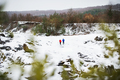 A senior couple jogging in snowy winter nature. - PhotoDune Item for Sale