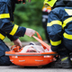 Firefighters putting an injured woman into a plastic stretcher after a car accident. - PhotoDune Item for Sale