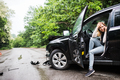 Young woman in the damaged car after a car accident, making a phone call. - PhotoDune Item for Sale