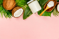 Coconut oil, tropical leaves and fresh coconuts - PhotoDune Item for Sale