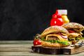 Homemade hamburgers on wooden background - PhotoDune Item for Sale