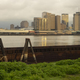 The Mississippi River Flows By The Barges and Buildings New Orleans - PhotoDune Item for Sale