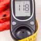 Glucose meter for checking sugar level, portion of watermelon and centimeter - PhotoDune Item for Sale