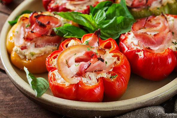 Stuffed peppers with cottage cheese and bacon in plate on the wooden table. Balkan food. - Stock Photo - Images