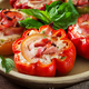 Stuffed peppers with cottage cheese and bacon in plate on the wooden table. Balkan food. - PhotoDune Item for Sale