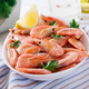 Boiled  shrimps or prawns on a white bowl on a white table. Seafood. - PhotoDune Item for Sale