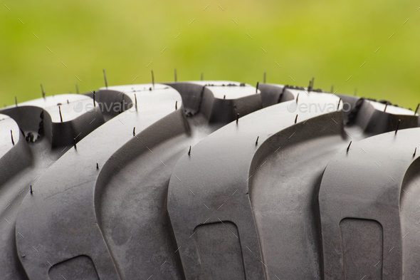 Pattern of black tyre of vehicle or agricultural machine, technology - Stock Photo - Images
