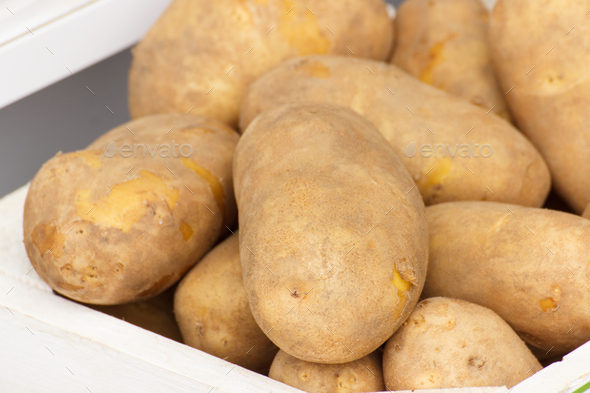 Fresh potatoes in wooden box, healthy nutrition concept - Stock Photo - Images
