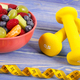 Fresh fruit salad and centimeter with dumbbells, healthy lifestyle and nutrition - PhotoDune Item for Sale