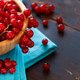 Ripe red currant berries in a bowl on a blue napkin - PhotoDune Item for Sale