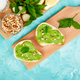 Bruschetta with pesto sauce, parmesan cheese and fresh basil - PhotoDune Item for Sale