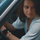 Close-up preety woman portrait holding hands on the steering whe - PhotoDune Item for Sale