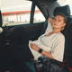 Woman is sitting in the back seat of the car - PhotoDune Item for Sale