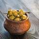 Bowl of olives on the wooden table - PhotoDune Item for Sale