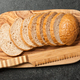 Fresh sliced bread on wooden cutting board - PhotoDune Item for Sale