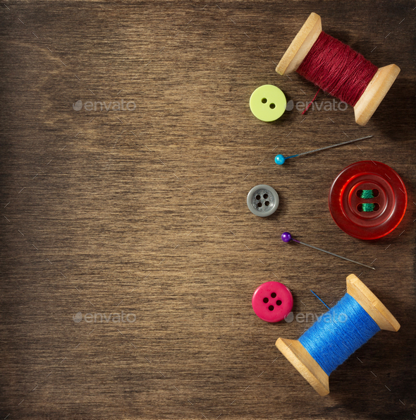 sewing tools on wooden background - Stock Photo - Images