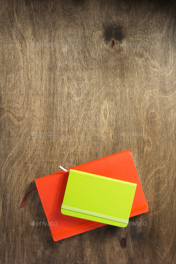 colorful notebook at wooden background - Stock Photo - Images