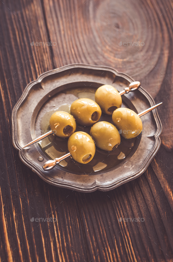 Olive skewer on the vintage plate - Stock Photo - Images