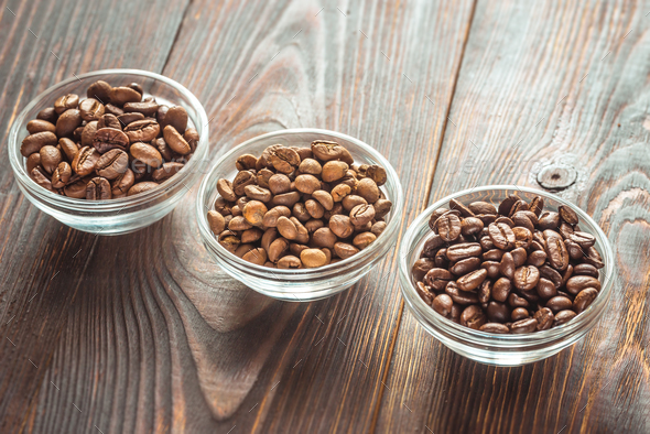 Bowls of different types of coffee beans - Stock Photo - Images