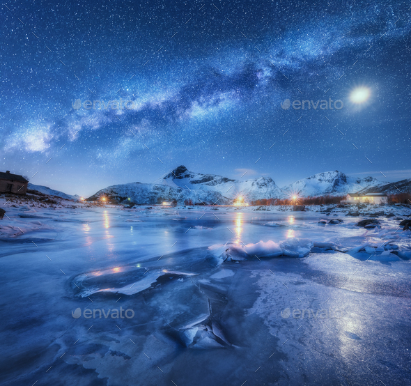 Milky Way above frozen sea coast, snow covered mountains - Stock Photo - Images