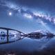 Bridge and starry sky with Milky Way over snow covered mountains - PhotoDune Item for Sale