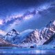 Milky Way above houses and snow covered mountains in winter - PhotoDune Item for Sale