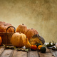 Thanksgiving concept with colorful pumpkins and fall leaves on rustic wooden table, copy space - PhotoDune Item for Sale