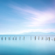 Poles and soft water on sea landscape. Long exposure. - PhotoDune Item for Sale