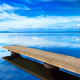 Pier or jetty, sunset blue panoramic landscape. Orbetello lagoon - PhotoDune Item for Sale