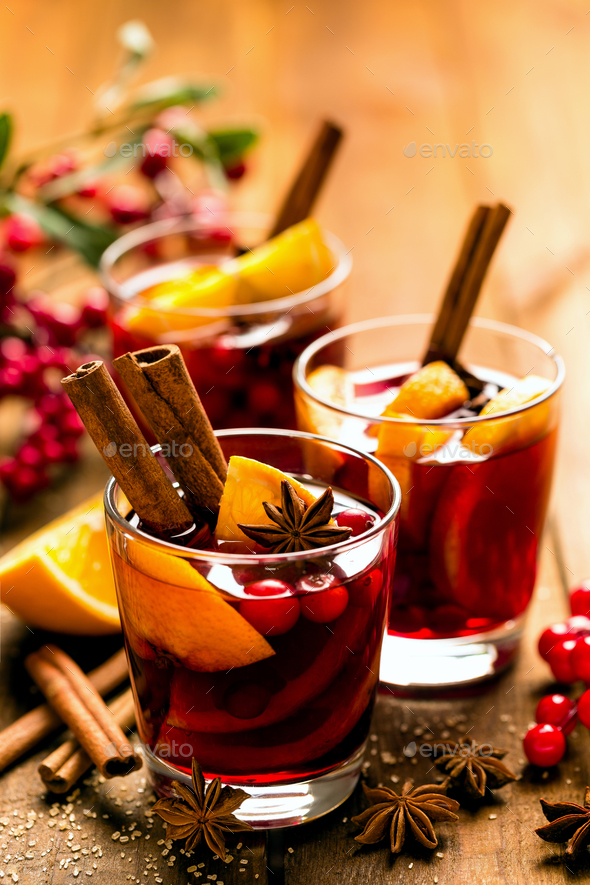 Christmas mulled red wine with spices and oranges - Stock Photo - Images