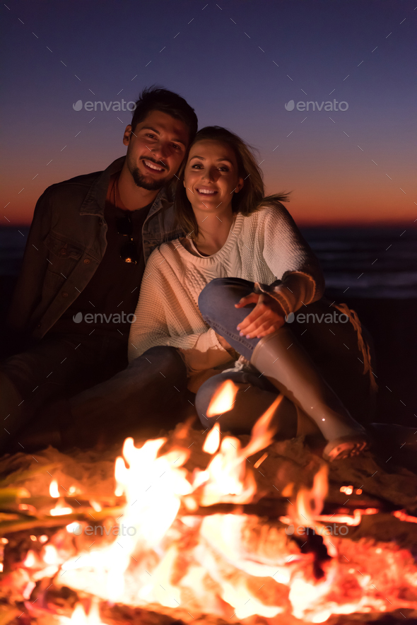 portrait of young Couple enjoying  at night on the beach - Stock Photo - Images