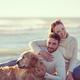 Couple with dog enjoying time on beach - PhotoDune Item for Sale
