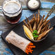 Beer snack deep fried small fishes with carrots sticks - PhotoDune Item for Sale