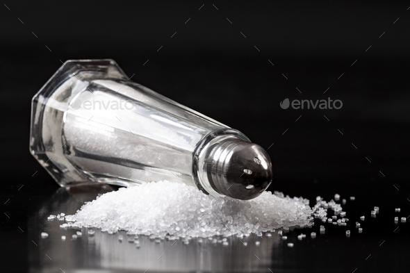 Salt Shaker on Salt Pile - Stock Photo - Images