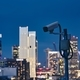Security camera against urban skyline - PhotoDune Item for Sale