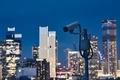 Security camera against urban skyline - PhotoDune Item for Sale