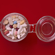colorful pills isolated on red background overhead shot - PhotoDune Item for Sale