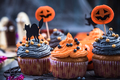 Black and orange cupcakes decorated for Halloween - PhotoDune Item for Sale