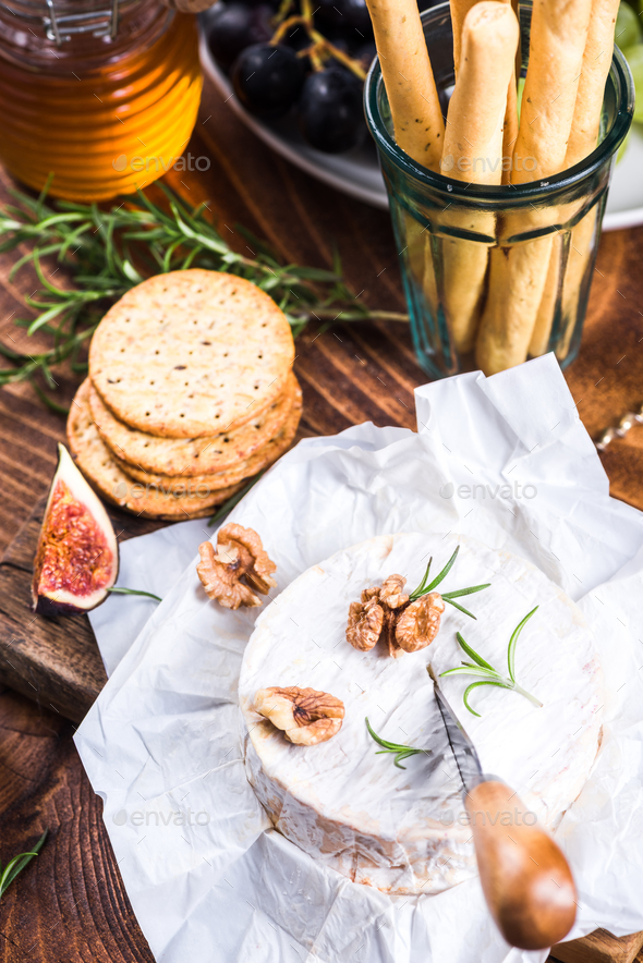 Serving camembert cheese, festive Christmas food - Stock Photo - Images