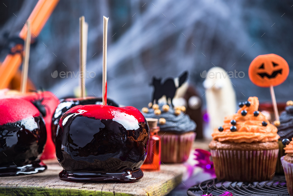 Glazed candy apples on Halloween party table - Stock Photo - Images