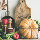 Autumn food ingredients and utensils over cupboard chest, vertical composition - PhotoDune Item for Sale