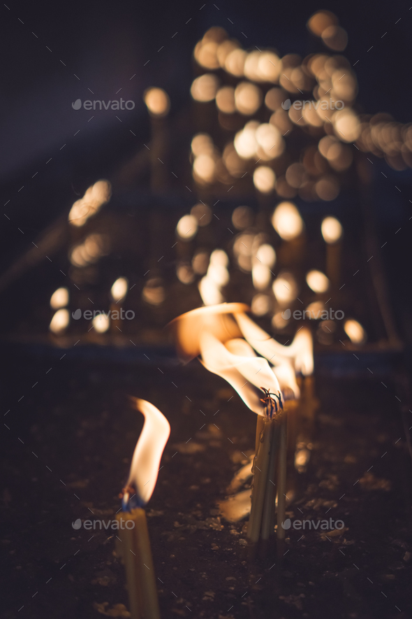 Burning memorial candles in the chapel - Stock Photo - Images