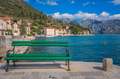 Empty bench on the  shore in Perast town - PhotoDune Item for Sale