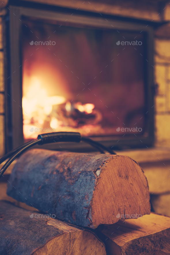 Firewood and burning fireplace at home - Stock Photo - Images