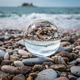 Beach peebles reflected in a galss ball - PhotoDune Item for Sale